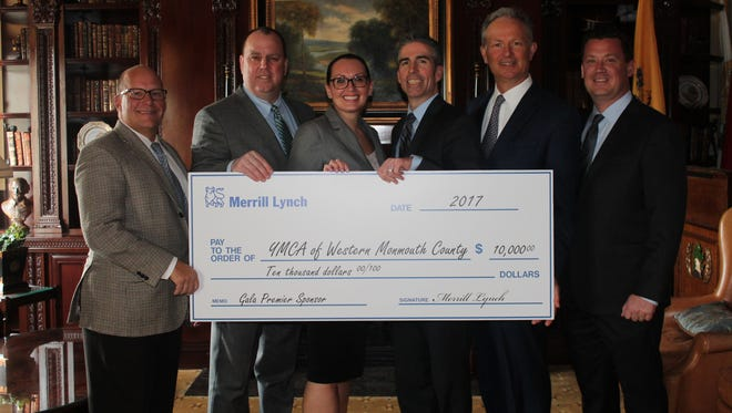 Merrill Lynch Wealth Management team with Y honoree, Patrick Preston, & Y Board Member & Gala Chair, Ken Thomson. (pictured, from left: Gustav Fingado, Patrick Preston, Kristen Sohnen, Kenneth Thomson