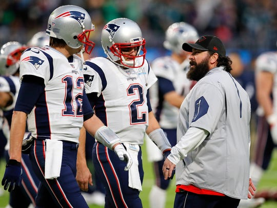 Patriots quarterbacks Brian Hoyer (2) and Tom Brady (12), and defensive coordinator Matt Patricia talk during warmups prior to Super Bowl LII against the Eagles on Feb. 4, 2018 in Minneapolis.
