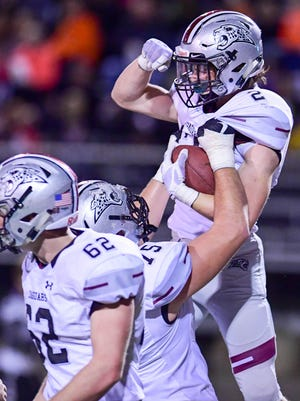 Ankeny Centennial's John Yount (75) holds Jensen Gates (2) in the air after scoring a touchdown on Friday, Nov. 04, 2016, during the quarter final football between the Ankeny Centennial Jaguars and the Valley Tigers at Valley High School stadium.