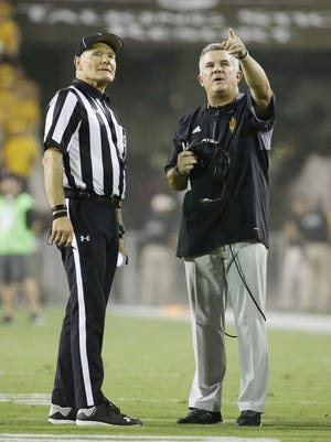 Arizona State head coach Todd Graham watches a replay of their first touchdown on the new video board against New Mexico State in the first quarter at Sun Devil Stadium on Thursday, August 31, 2017 in Tempe, Ariz.