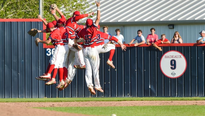 Teurlings Catholic's Rebels, shown here celebrating during Friday's win over Loyola Prep, is headed back to the 4A state tournament in Sulphur.