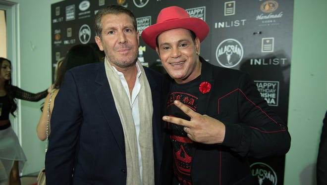 Sammy Sosa, right, attends a party in Miami Beach, Fla., in 2017.
