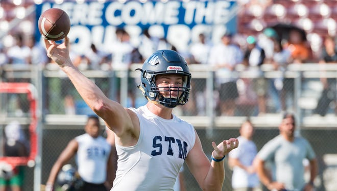 St. Thomas More junior quarterback Caleb Holstein rifles a pass during the Quick Slants 7-on-7 tournament at STM on Thursday, July 12, 2018.