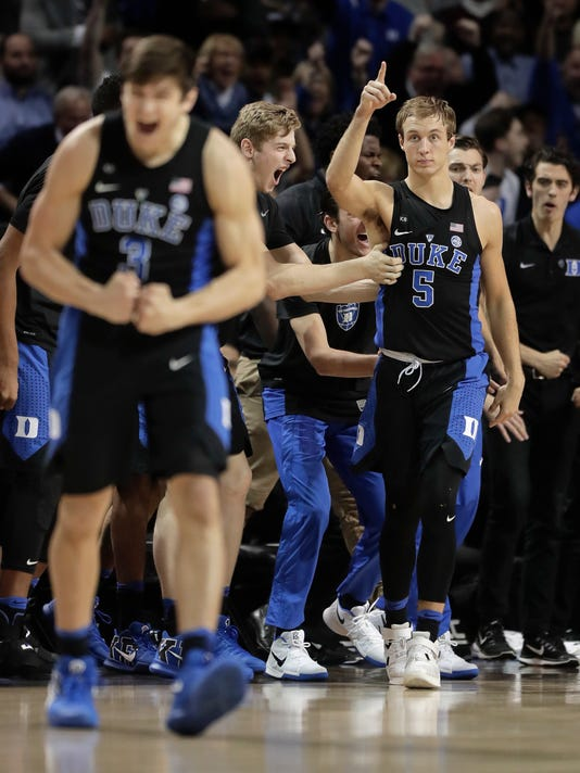 Duke guard Luke Kennard (5) reacts after hitting a 3-point shot against the North Carolina in the second half of an NCAA college basketball game during the semifinals of the Atlantic Coast Conference tournament, Friday, March 10, 2017, in New York. Duke won 93-83.(AP Photo/Julie Jacobson)
