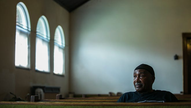 """James E. """"Chuck'' Wilson, an ex-convict whose 1970 death sentence for murder was converted to life before he was paroled in 2007, sits inside Rock of Faith Baptist Church in Columbus, Ohio, on July 17, 2017. Wilson runs a prison ministry with evangelist Bob Duckens in London, Ohio."""