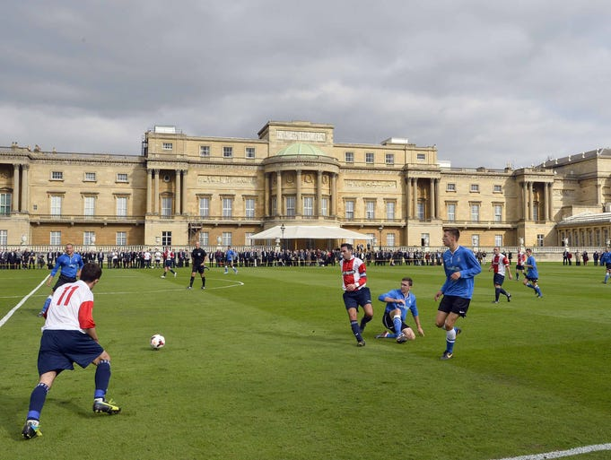 A view of action during the Southern Amateur League soccer match between Polytechnic FC and Civil Service FC on the grounds of Buckingham Palace. The two teams played the first ever match at Buckingham Palace as part of a celebration marking the Football Association's 150th anniversary.