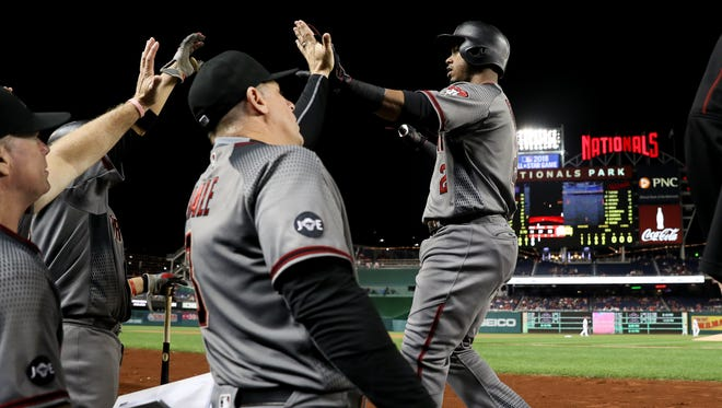 Arizona Diamondbacks second baseman Jean Segura (2) is congratulated after hitting a solo home run during the 4th inning of a baseball game at Nationals Park in Washington, Monday, Sept. 26, 2016.