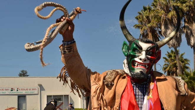 Francisco Reyes with Danza de los Diablos entertains the crowd with his bullwhip in the 2014 Fiestas Patrias Parade celebrating Mexican Independence Day. This year's parade starts at 11 a.m. Sunday in downtown Oxnard.