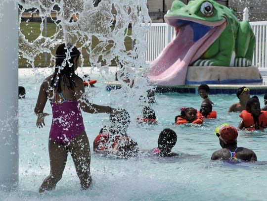 Kids play in the pool at the Bell Road YMCA. An expansion