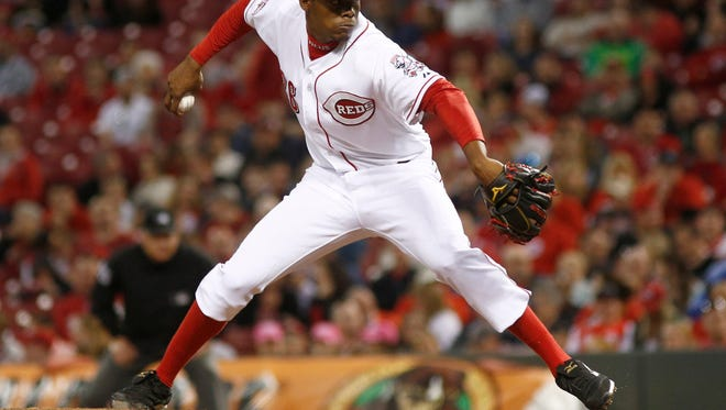 May 13, 2015; Cincinnati, OH, USA; Cincinnati Reds starting pitcher Raisel Iglesias (26) throws against the Atlanta Braves in the eighth inning at Great American Ball Park. The Reds won 5-1. Mandatory Credit: David Kohl-USA TODAY Sports