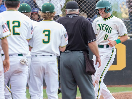 """Manogue's C.J. Hires is congratulated by teammates after hitting a home run against Reno in the NIAA 4A Northern Regional Baseball Championship """"if game"""" at Galena High School in Reno on Saturday."""