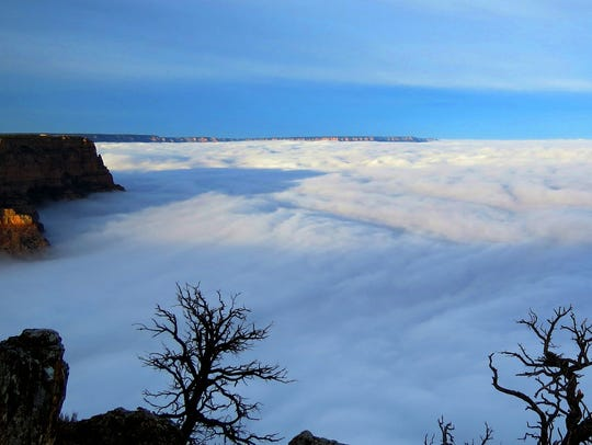 A different view of the Grand Canyon, filled with clouds