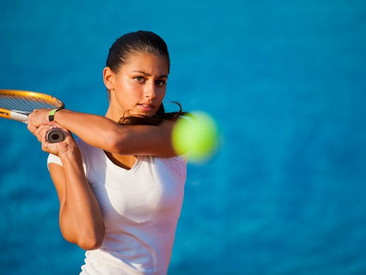 Beautiful young woman playing tennis