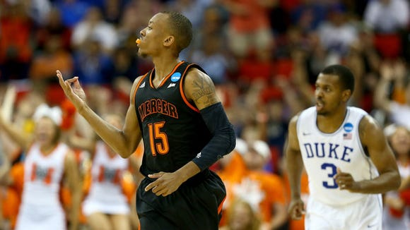 Former Pike guard Anthony White Jr. helped Mercer to an NCAA Tournament win over Duke.