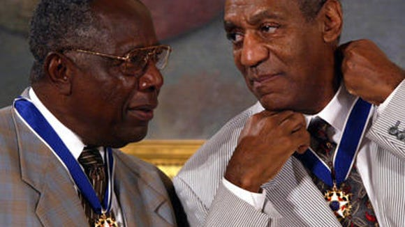Comedian Bill Cosby adjusts his Presidential Medal