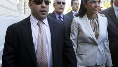 Joe and Teresa Giudice walk outside the federal courthouse in July 2013 in Newark, N.J.