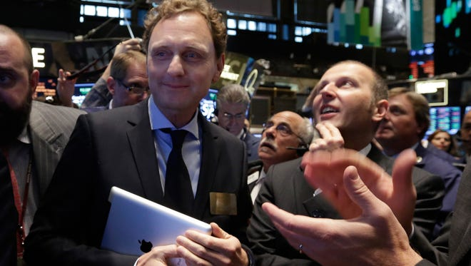 Voxeljet CFO Rudolf Franz, left, and CEO Ingo Ederer watch as their company's IPO begins trading on the floor of the New York Stock Exchange on Friday.