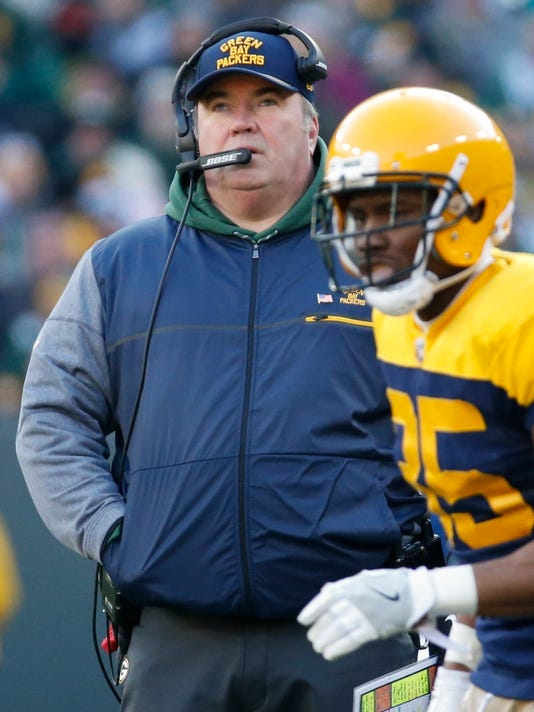 Green Bay Packers head coach Mike McCarthy watches during the second half of an NFL football game against the Baltimore Ravens Sunday, Nov. 19, 2017, in Green Bay, Wis. (AP Photo/Mike Roemer)