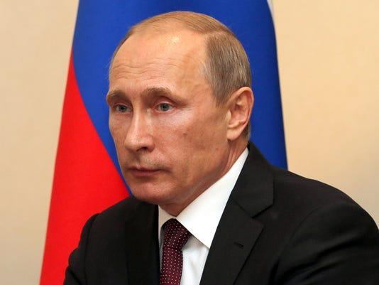 -FALBrd_06-25-2014_Tribune_1_A002~~2014~06~24~IMG_Putin_mug_3_1_7D7P2VP7_L44.jpg