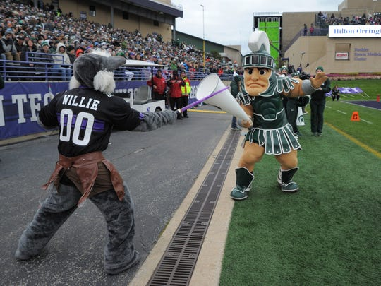 Oct 28, 2017; Evanston, IL, USA; Northwestern Wildcats mascot Willie and Michigan State Spartans mascot Sparty battle during the first half at Ryan Field.