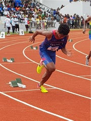 Team Guam 400M runner Athan Arizanga takes off in Heat 2 during track and field action in Port Vila, Vanuatu for the X Pacific Mini Games.