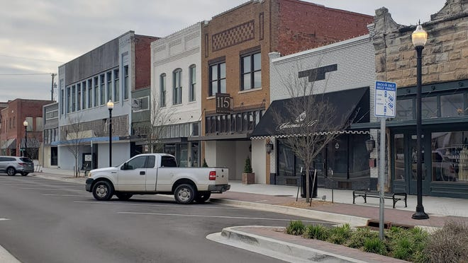 The parking spaces along Main Street were almost empty on Friday afternoon as the community embraces social distancing.