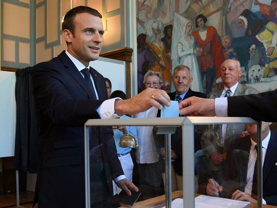 French President Emmanuel Macron casts his ballot in