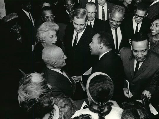 Martin Luther King Jr. (center) is greeted by well wishers during his visit to the Milwaukee Auditorium  (now the Miller High Life Theatre) on Jan. 27, 1964. This photo was published in the Jan. 28, 1964, Milwaukee Sentinel.