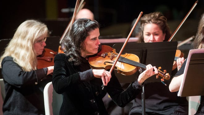 Noelle Tretick Gosling plays with the Muncie Symphony Orchestra Sunday afternoon for a concert honoring Dr. Martin Luther King. Gosling is one of two new members added this year.