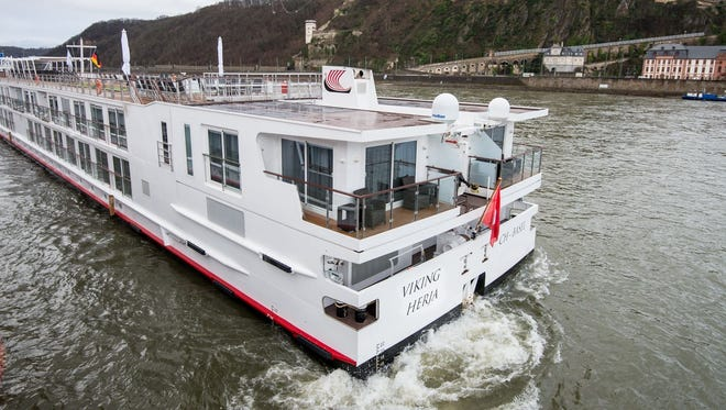 """Named for a mighty Valkyrie and the """"Decider of Fates,"""" Viking Herja is the 48th Longship launched by Viking River Cruises since 2012. The ship is seen here in Koblenz, Germany, beneath an imposing 12th-century fortress."""