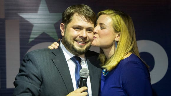 Democrat Ruben Gallego gets a congratulatory kiss Tuesday night from his wife, Phoenix City Council woman Kate Gallego, at his election-night victory party at Club Downtown in Phoenix. Gallego was running in the primary against Mary Rose Wilcox for the 7th District to replace retiring U.S. Rep. Ed Pastor.