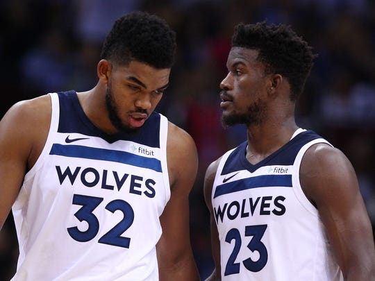 Jimmy Butler #23 and Karl-Anthony Towns #32  of the