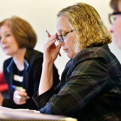 York County Coroner Pam Gay, center, reviews some material