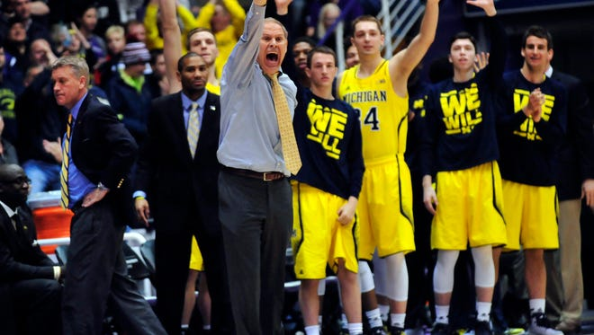 Michigan Wolverines head coach John Beilein shouts instructions during the first overtime at Welsh-Ryan Arena. The Northwestern Wildcats defeated the Michigan Wolverines 82-78 in double overtime.