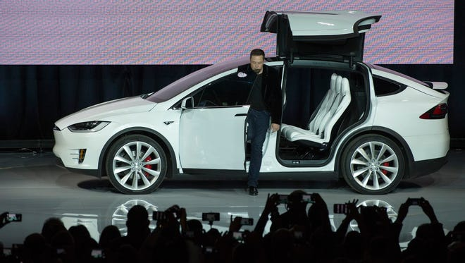 9/29/15 11:09:03 PM -- TESLA MODEL X UNVEILED --- Fremont, CA: Tesla Motors  CEO Elon Musk unveils the Model X at a launch event in Fremont, Calif. The Tesla Motors X is an all-wheel drive SUV featuring a 90 kWh battery providing 250 miles of range and will be able to go from 0 to 60 mph in 3.2 seconds. Photo by Robert Hanashiro, USA TODAY staff  -- Tesla is unveiling the Model X, their second model.  --     ORG XMIT:  RH 133792 tesla Model X 09/29/2015 (Via OlyDrop)