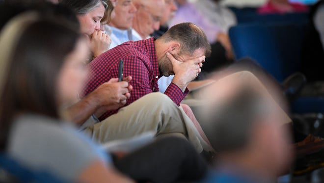Guests pray during a vigil at Woodmont Hills Church of Christ on Monday, Sept. 25, 2017, for victims of the Burnette Chapel Church of Christ mass shooting that happened during Sunday morning services.