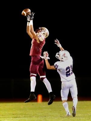 Riverdale's Troy Hutson leaps high to make a catch over Cookeville's J.P. Bush during the two teams' regular-season meeting, won by Riverdale 30-28. The Warriors travel to Cookeville for a second-round 6A state playoff game Friday.