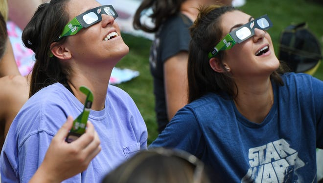 Greenville Drive fans try out their solar eclipse glasses at Fluor Field at The West End. on Monday, August 21, 2017.