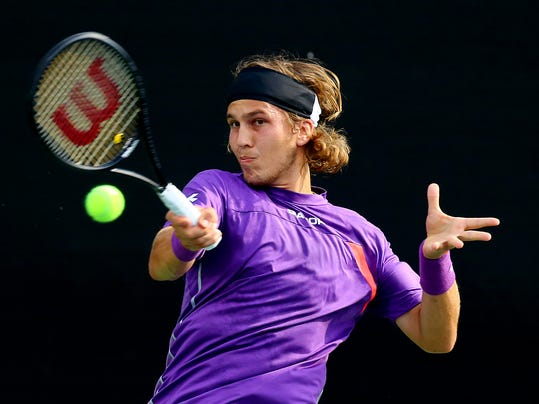 Lukas Lacko, of Slovakia, returns a shot to Denis Istomin at the BB&T Atlanta Open on Wednesday, July 23, 2014, in Atlanta.   (AP Photo/Atlanta Journal-Constitution, Curtis Compton)  MARIETTA DAILY OUT; GWINNETT DAILY POST OUT; LOCAL TELEVISION OUT; WXIA-TV OUT; WGCL-TV OUT