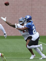 Cornerback, Eli Apple breaks up this pass meant for Odell Beckham Jr. at Giants training camp on July 29, 2017.