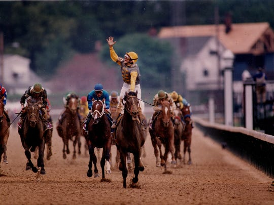 "A jubilant Jerry Bailey crossed the finish line on Sea Hero after charging from behind. ""It was like the Red Sea-every time I got into a position that would be crucial, they would part for me,"" he said. May 1, 1993"
