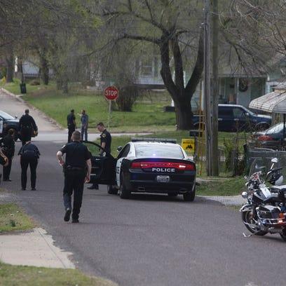 Springfield police investigating a scene near College