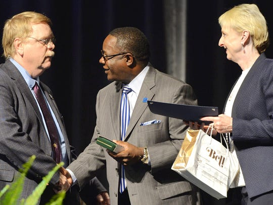 Carroll Van West, left, director of MTSU's Center for Historic Preservation and the Tennessee state historian, accepts the 2015 Career Achievement Award from university President Sidney A. McPhee, center, and MTSU Foundation President Kathy Jones at the Aug. 21 Fall Faculty Meeting in Tucker Theatre.