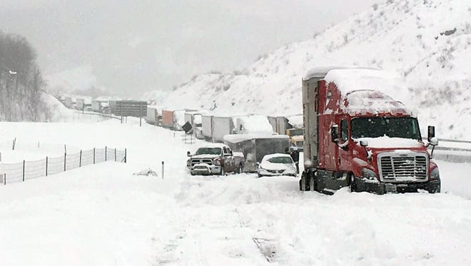 In this photo provided by Michael Watkins, traffic is at a standstill on the Pennsylvania Turnpike near Bedford, Pa., Saturday, Jan. 23, 2016.   The Duquesne men's basketball team and Temple University's women's gymnastics team are stuck on the Turnpike due to treacherous weather conditions. A mammoth winter storm crawled up the U.S. East Coast on Saturday, making roads impassable, shutting down mass transit, and bringing Washington and New York City to a standstill. (AP Photo/Michael Watkins via AP)