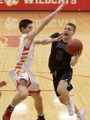 Carlisle junior Tommy Donovan tries to defend against