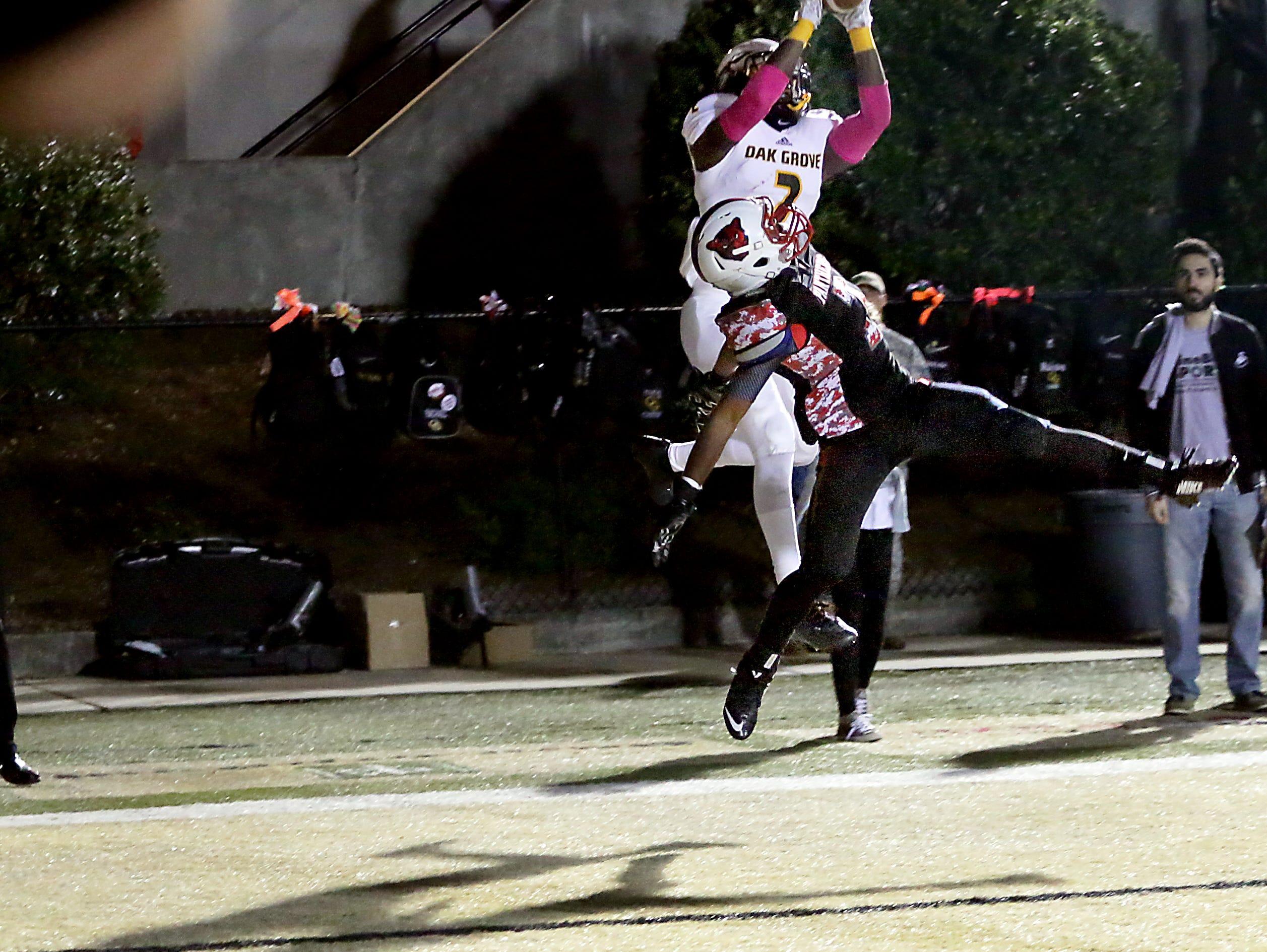 Oak Grove player Jordan Ducan (2) catches the ball for an Oak Grove touchdown during a game against Petal High School at Oak Grove High School Friday.