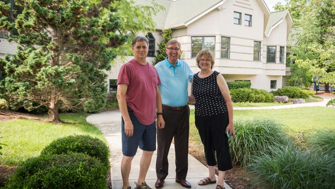 From left: Ken Piety, Pastor Gerald McGinnis and Linda Gordon stand in front of Piety and Gordon's home, which is for sale on Lobetti Road in Knoxville. McGinnis hopes to create a veterans facility upon raising enough funds to buy Gordon and Piety's home.