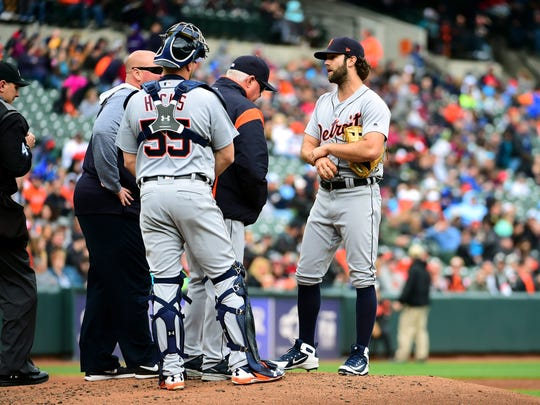 Tigers pitcher Daniel Norris, right, is removed from the game by manager Ron Gardenhire (middle) after an apparent injury in the third inning on Sunday, April 29, 2018, in Baltimore.