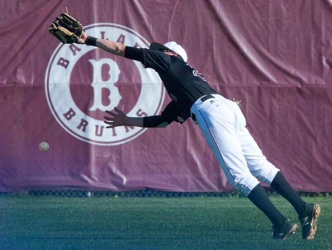 Ballard 2nd baseman Michael Dwyer can't come down with a fly ball to short center field. Ballard defeated Lexington Catholic 9-6. 25 April 2014