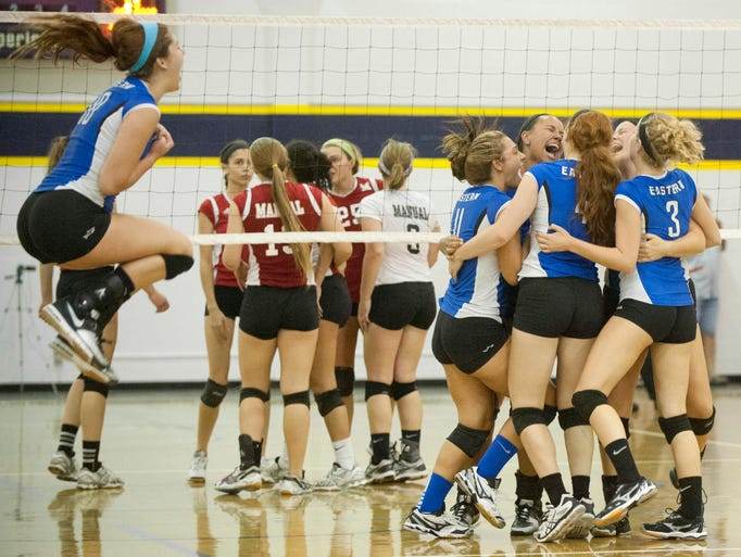 Eastern Eagles' Megan Willoughby, left, jumps for joy as she joins her teammates in celebrating their win over Manual. Eastern defeated Manual, 48-46, 19-25, 25-19 to win the Jefferson County Volleyball Tournament championship. 24 August 2014